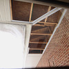 Record-Eagle/Jan-Michael Stump<br />  Leelanau County Government Center maintenance director Jerry Culman, II, removed part of the building's soffit and found that insulation wasn't installed properly.