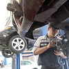 Record-Eagle/Jan-Michael Stump<br /> Matt Connors replaces the wheel bearings on an SUV at Bll Marsh Hyundai on Thursday afternoon. Bill Marsh and a number of other auto industry business that will be on hand for Tuesday's Auto and Diesel Technicians Night in Traverse City at NMC's Parsons-Stulen Building.