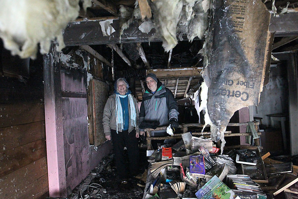 Record-Eagle/Jan-Michael Stump<br /> Sally Van Vleck, left, and Bob Russell stand in their bedroom at The Neahtawanta Inn, which was damaged in a fire Sunday.