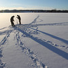 Record-Eagle/Jan-Michael Stump<br /> Al Ault, left, and Kelly Gunthorpe of Traverse City drill holes in the ice on Boardman Lake while looking for a spot to fish on Monday afternoon.