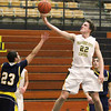 Record-Eagle/Jan-Michael Stump<br /> Traverse City Central's Tanner Kenney (22) drives for a layup over Gaylord's Cameron Taylor (23) in the second quarter of Tuesday's game.