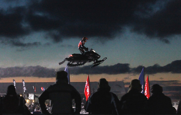 Record-Eagle/Jan-Michael Stump<br /> Travis Muller flies over a jump in a Pro Lite race in the Turtle Creek US 27 Motorsports Snocross Friday night at the Turtle Creek Casino in Williamsburg.