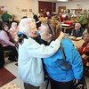 "Record-Eagle/Keith King<br /> Rena Fuller, left, of Benzonia, hugs her granddaughter, Denise Strom, of Frankfort, Wednesday, February 6, 2013 during a birthday celebration at The Gathering Place, in Honor, for Fuller, who turned 100 years old on her birthday, February 5.  During the celebration, Vance Bates, Benzie County commissioner, read a proclamation declaring February 5 ""Rena Fuller Day"" and Fuller was also given a pass allowing her to ride Benzie Bus for free."