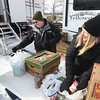 Record-Eagle/Keith King<br /> Volunteers Roger Evens, left, of Traverse City, and Julia Lilley, with Century 21, sort food that has been dropped off at the Garfield Centre Friday, February 8, 2013 during the 19th annual Father Fred Frostbite Food Drive. The food drive concludes on February 17.