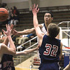 Record-Eagle/Jan-Michael Stump<br /> Traverse City St. Francis' Damon Sheehy (15) dishes a pass around Boyne City's Nick Vellis (32) in the second quarter of Tuesday's game.