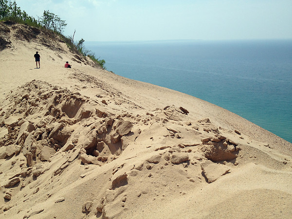 Record-Eagle/Vanessa McCray<br /> <br /> Visitors to the Sleeping Bear National Lakeshore look out over Lake Michigan Sunday from the top of a sand dune.Record-Eagle/Vanessa McCray<br /> <br /> Visitors to the Sleeping Bear Dunes National Lakeshore look out over Lake Michigan Sunday from the top of a sand dune.
