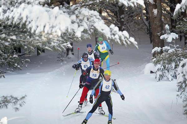 Record-Eagle/Keith King<br /> Cross country skiers race through the woods Saturday, February 2, 2013 during the 37th annual White Pine Stampede.