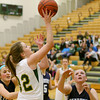 Record-Eagle/Keith King<br /> Traverse City West's Abbey Fashbaugh (32) shoots the ball against Petoskey's Kelsey Ance (12), right, and Hannah Scholten (3), left, Thursday, February 7, 2013 at Traverse City West High School.