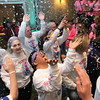 Record-Eagle/Jan-Michael Stump<br /> A.J. Maynard (cq) of Area16, Kalamazoo County, enters the opening ceremonies for the Special Olympics State Winter Games with teammates in a cloud of bubbles Wednesday evening at the Grand Traverse Resort and Spa. About 800 athletes from around the state will participate in the games, which run through February 8th at the resort, Schuss Mountain at Shanty Creek Resort and Howe Arena.