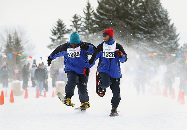 Record-Eagle/Keith King<br /> Deandre Hill (1309), left, and Javarrice Buckley (1325) compete in the 50-meter snowshoe finals Friday, February 8, 2013 at Grand Traverse Resort and Spa in Acme during the Special Olympics Michigan Winter Games.