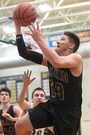 Record-Eagle/Pete Rodman<br /> Leland's Jamie McFarlane shoots against Buckley during a high school boys basketball game on Thursday at Buckley Community School.