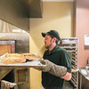 Record-Eagle/Keith King<br /> Mac Johnson removes pies from an oven Wednesday at the Grand Traverse Pie Company near the intersection of Front Street and Park Street in downtown Traverse City.