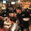 Record-Eagle/Keith King<br /> Paula Stolz serves food to a group of people Thursday at Geno's Sports Bar and Grill in Thompsonville.