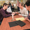 Record-Eagle/Keith King <br /> Guy Morey, from left, a Traverse Bay Area Intermediate School District (TBAISD) student with autism, is joined by Brian Jean and Amanda Fouchey, both Traverse City West High School students, as they make a hand puppet Thursday during the Peer-to-Peer Mentoring Program for Students with Autism at Traverse City West High School. The puppets are planned to be used for an upcoming skit as part of the program.