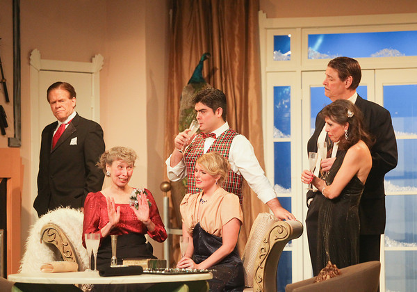 "Record-Eagle/Keith King<br /> Jan Dalton, from left, playing William Gillette, Bernadette Groppuso, playing Martha Gillette, Meg Parker, middle bottom, playing Aggie Wheeler, Christopher Boyer, middle top, playing Simon Bright, Susan McConnell, right bottom, playing Madge Geisel and Joe Kilpatrick, right top, playing Felix Geisel, rehearse a scene from ""The Game's Afoot or Holmes for the Holidays,"" Wednesday at the Old Town Playhouse."