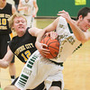 Record-Eagle/Keith King<br /> Traverse City West's Jonny Wheelock (22), right, and Traverse City Central's Zach Egbert (12), battle for the ball Thursday at Traverse City West High School.