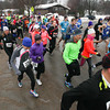 Record-Eagle/Keith King<br /> Runners take off from the starting line on Eastern Avenue Saturday during the annual Frozen Foot Race, a five-mile road race, in Traverse City.