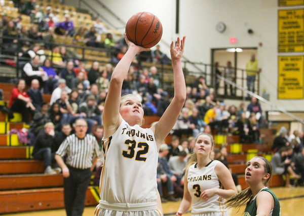 Record-Eagle/Keith King<br /> Traverse City Central's Carolyn Wynkoop (32) puts the ball up against Traverse City West Friday at Traverse City Central High School.