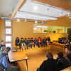 "Record-Eagle/Keith King<br /> Jim Olson, at lower left, environmental attorney and partner in the law firm, Olson, Bzdok and Howard, in Traverse City, speaks as Greenspire School students listen in the school's new building Friday during a symposium as part of the ""PeaceJam"" curriculum ."