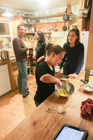Record-Eagle/Keith King<br /> David Moehle, from left, Amy Daniels Moehle, Sonja Daniels Moehle, 9 and Nadia Daniels Moehle, 13, of Beulah, prepare dinner in their kitchen.