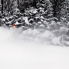 """Record-Eagle/Jan-Michael Stump<br /> Britt Sanford plows the driveway of his Dracka Road home on a cold Friday morning. """"Could be in Florida, I guess,"""" said Sanford, who said his snowblower made clearing his driveway tolerable."""