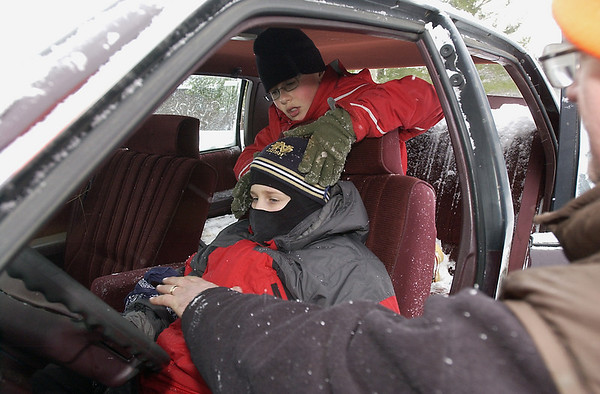 """Record-Eagle/Garret Leiva<br /> Robert Ensign, back, treats Jacob Wilkins for """"injuries"""" in a car-crash scenario at the seventh annual first-aid Klondike Derby."""