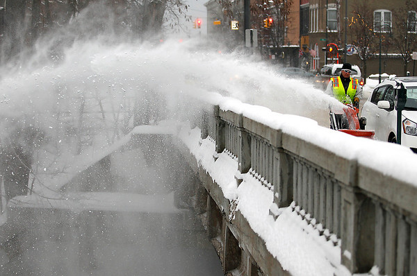 Record-Eagle/Jan-Michael Stump<br /> Cindy Anderson, of the Traverse City Parks and Recreation Department, snowblows the sidewalk on the Union Street Bridge on Tuesday morning.