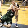 Record-Eagle/Keith King<br /> Traverse City St. Francis' Michael Jenkins battles with Grayling's Griffin Dean (42).