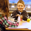 "Record-Eagle/Jan-Michael Stump<br /> Alex Matis talks with a classmate while opening his milk for breakfast in Erika Olvey's second grade class at Blair Elementary School, where breakfast is available for all students every morning. ""It takes about 10 minutes out of our day, but it's worth it,"" said Olvey."