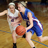 Record-Eagle/Keith King<br /> Gaylord St. Mary player, Christina Smith, drives to the basket against Central Lake's Lauren Rogers Wednesday, January 19, 2011 at Central Lake High School.