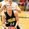 Record-Eagle/Keith King<br /> Traverse City Central's Madi Bankey goes up for a bucket in front of two Traverse City  West defenders.