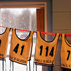 "Record-Eagle/Jan-Michael Stump<br /> ""Necessity is the mother of invention,"" said volunteer Mary Guy, who make a clothesline from duct tape to dry racing numbers in the race office during the Kalkaska Winterfest Saturday at the Kalkaska Civic Center."