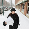 Record-Eagle/Keith King<br /> Colleen Paveglio, marketing director with the Traverse City Downtown Development Authority, holds downtown Traverse City gift certificates on Monday.