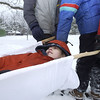 Record-Eagle/Garret Leiva<br /> J.D. Wiener gets a ride on a stretcher from his fellow Boy Scouts from Troop 34. The Klondike Derby was sponsored by the Scenic Trails Council and hosted by Explorer Post 20 and Troop 20.