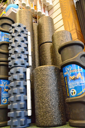 "Record Eagle Photo/Allison Batdorff<br /> Foam rollers range in shape, size and price. Serious rollers can spend upwards of $80 on the cylinders, which are differentiated primarily by density – or ""squishiness."" The ideal roller should give a little but then push back."