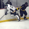Record-Eagle/James Cook<br /> TC West forward John Linenger (22) evades Gaylord's Cam Laug (7) during the Titans' 8-0 win Wednesday over the Blue Devils at Howe Arena.