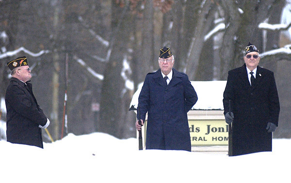 Record-Eagle/Nathan Payne<br /> Bill Volkening, Larry Kidd and Don Randall stand at attention while waiting for their que to fire a 21-gun salute at a funeral service for Clinton Kinney on Monday afternoon at Reyonlds-Jonkhoff Funeral Home. Kinney, a veteran of the World War II, fought from 1943 to 1946 in England and France with the Third Army. The honor guard consisting of members of VFW Post 2780 and American Legion Post 35 stood outside the funeral home waiting to perform their duty while temperatures hovered near 10 degrees.