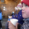 Record-Eagle/Nathan Payne<br /> Reece Robertson, 11, sips on a cup of hot cocoa Monday afternoon while taking a break from skating on an outdoor skating rink near downtown Traverse City. Children and families often flock to a handful of city-maintained rinks during days off from school, said Greg Denoyer, a rink supervisor who works for the city. The warming hut was a popular place during the afternoon while yet another blast of arctic air descended on the region. Temperatures today are expected to peak at 8 degrees, according to the National Weather Service.