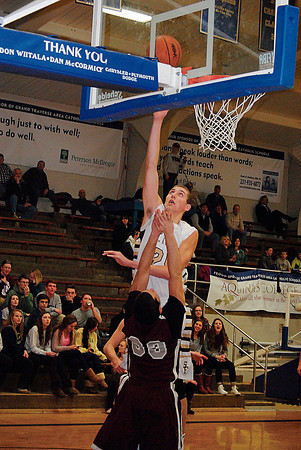 Record-Eagle/James Cook<br /> TC St. Francis center Noah Phillips (25) goes up for two points over Charlevoix's C.J. Rice (33). Phillips scored 31 points in TCSF's 76-65 win.