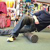 "Record Eagle Photo/Allison Batdorff<br /> Marc McCombs demonstrates foam rolling — a concept based on using body weight to roll out the fascia (or connective tissue beneath the skin) like cookie dough to break up knots and increase blood flow around the body.  The Traverse City-based personal trainer has seen this fitness practice ""explode"" in popularity in recent years and sells them every day in his job at Running Fit."