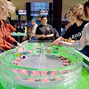 "Record-Eagle/Keith King<br /> Dawn Buchanan, left, a dealer at Turtle Creek Casino, works at a roulette table made of ice as Erin O'Malley, from right, Simone Petoskey, Carlee Novak and Veronica Ramos, all of Traverse City, play at the ice roulette table Monday at Turtle Creek Casino. A craps and blackjack table made of ice were also being used as they were taped for a new series on The Food Network called, ""Ice Brigade."" The broadcast date is currently set for spring 2011."