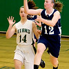 Record-Eagle/Keith King<br /> Petoskey's Kelsey Ance looks to make a pass as Traverse City West's Lauren Ellison pursues her Friday at TC West.