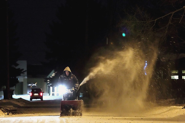 Record-Eagle/Jan-Michael Stump<br /> Jesse Boothroyd snowblows behind his 13th Street home.