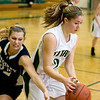 Record-Eagle/Keith King<br /> Traverse City West's Mallory Litwiller, right, is pressured by Katelyn Crittenden Friday.