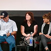 """Record-Eagle/Jan-Michael Stump<br /> Cuban director Ian Padron puts on a New York Yankees hat as interpreter Bryn Lynch, center, and actress Mirta Ibarra watch during Friday's """"We Live in Cuba and We Make Movies"""" panel at the City Opera House."""