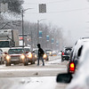 Record-Eagle/Jan-Michael Stump<br /> Traffic and pedestrians make their way through fresh snowfall along West Front Street on Thursday afternoon.