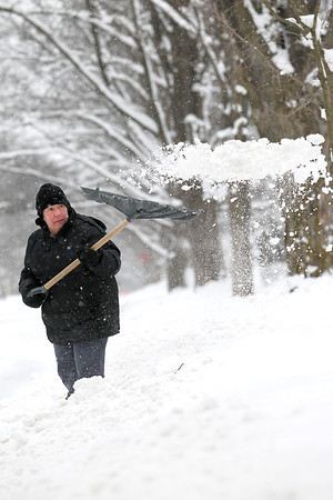 "Record-Eagle/Jan-Michael Stump<br /> ""It's like we're getting all our winter in one week"" said Katherine Sleder (cq) as she shoveled the driveway of her Monroe Street home in Traverse City, Mich, on Fiday, January 25, 2013."