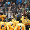 Record-Eagle/Jan-Michael Stump<br /> Traverse City Central players celebrate their 2-1 win over Traverse City West with the Jeff McCullough Memorial Challenge Cup and their student section Wednesday at Howe Arena.