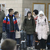 Record-Eagle/Jan-Michael Stump<br /> Traverse City West High School assitant principal Juleen Jenkins-Whall welcomes exchange students Monday evening as part of a 50 student delegation from China's The High School Attached to Dalian University of Technology. The students, 25 at West and 25 at Traverse City Central High school, plus 4 teachers, will spend the next four weeks in Traverse City. Their hometown, Dalian, is a port and trading city f about 5.65 million people in northeastern China.
