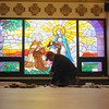 Record-Eagle/Jan-Michael Stump<br /> Greg Galla of Grand Traverse Construction gathers extra wood trim in the chapel in the Carmelite Monastery Friday, where a nearly year-long renovation project is nearing completion.